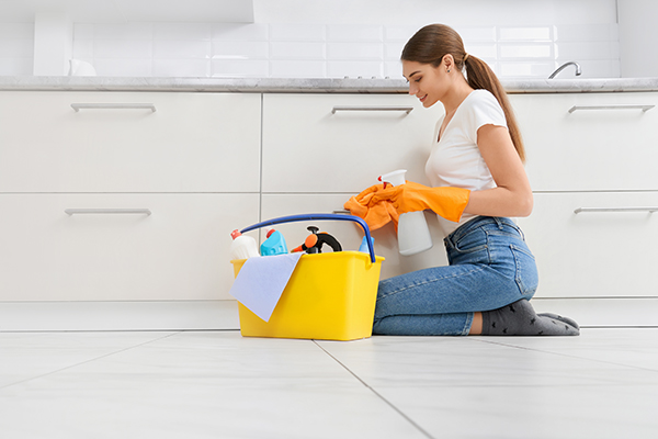 tile and grout cleaning at home - woman